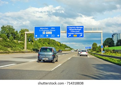motorway road sign on (Autobahn A 8) direction Munich, Ulm - Airport / Messe, exit S Degerloch Mohringen, Filderstadt Leinfelden-Echterdingen B27