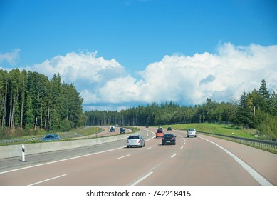 motorway to stuttgart - three-lane road with cars