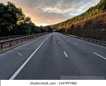 Motorway at sunrise - driver pov