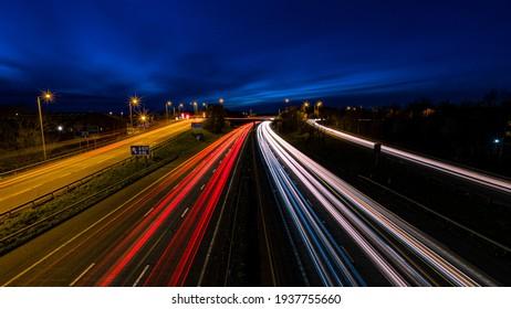 Motorway traffic light streaks with dusk blue sky