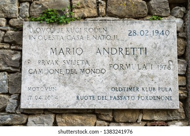 Motovun, Croatia, April 06. 2019.signboard on old house, birth house of Mario Andretti formula 1 driver