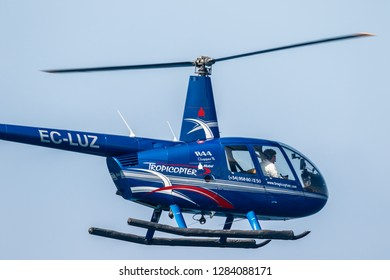 MOTRIL, GRANADA, SPAIN-JUN 11: Helicopter Robinson R44 taking part in an exhibition on the 12th international airshow of Motril on Jun 11, 2017, in Motril, Granada, Spain