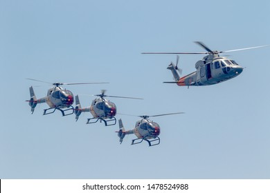 MOTRIL, GRANADA,  SPAIN-JUN 15: Patrulla Aspa, Helicopter Eurocopter EC-120  and Sikorsky S-76C taking part in an exhibition on the 13th airshow of Motril on June 15, 2018, in Motril, Granada, Spain