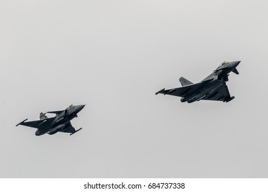MOTRIL,GRANADA,SPAIN-JUN 10: Aircraft Eurofighter Typhoon C-16 and Saab  Grippen taking part in a exhibition on the 12th international  airshow of Motril on June 10, 2017, in Motril, Granada, Spain