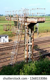 Motteville, Normandie, France, juin 2018. Electric railway pole with obsolescence traffic lights.  Pole in a poor condition, rust stains