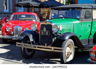 Motueka, Tasman/New Zealand - February 17, 2013: Vintage car show in Motueka High Street - close up of a Jaguar and a Ford. in front of the museum.