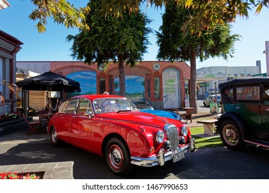Motueka, Tasman/New Zealand - February 17, 2013: Red Jaguar at a vintage car show in Motueka High Street in front of the museum.