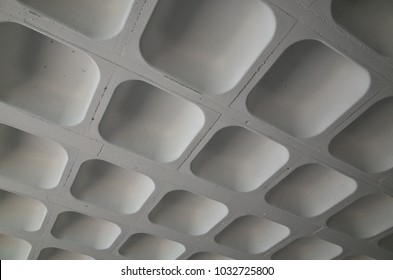 The moulded concrete ceiling of a car park photographed to provided an abstract background