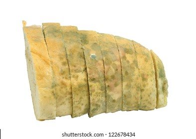 Mouldy bread sliced isolated on a white background