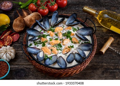 Moules mariniere, chowder, bouillabaisse and steamed mussels on the table. Healthy seafoods in the pan.