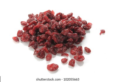 A mound of dried cranberries on a white background