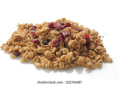 A mound of fresh granola with dried cranberries and raisins