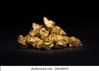 mound of gold close-up on black background