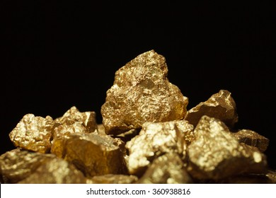 mound of gold close-up on black background