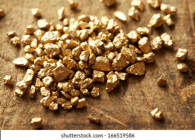 Mound of gold on a old wooden work table