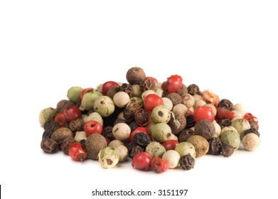 Mound of peppercorns isolated on white