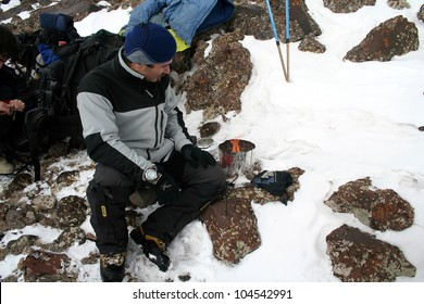 MOUNT AGRI, TURKEY - JANUARY 24: Mountaineer making soup at 4200 meters camp, January 24, 2007 in Agri, Turkey. Mount Agri  the highest mountain in Turkey and  believed that Noah Ark is there