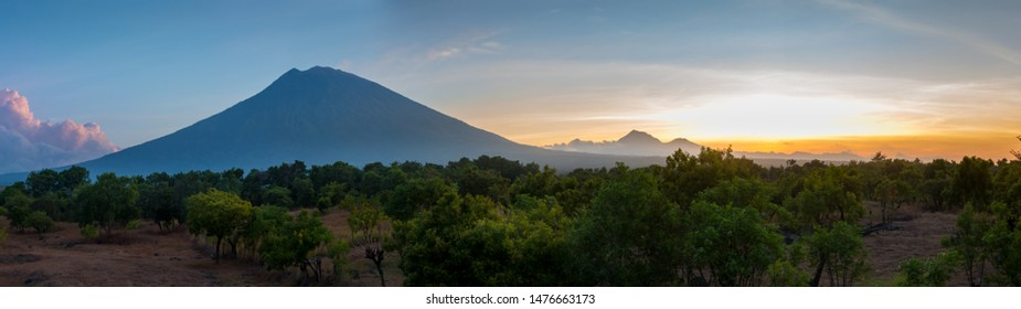 Mount Agung or Gunung Agung active volcano in Bali with Mount Batur volcano in the background Indonesia