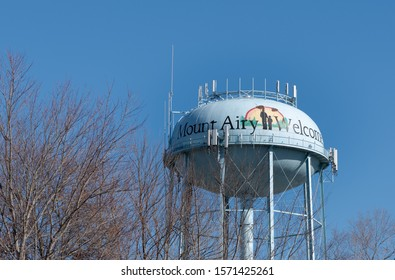 Mount Airy, North Carolina/ USA - November 25, 2019: This photo made of water tower in Mount Airy shows a painting depicting Andy Taylor and Opie Taylor from the Andy Griffith TV Show.(1960 to 1968).