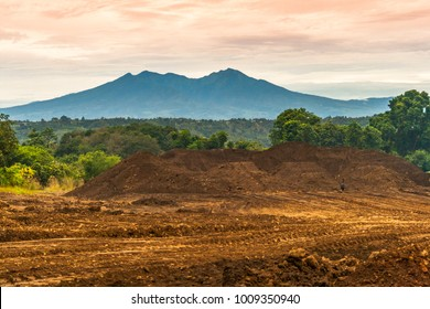 Mount Apo mountain as seen from Amakan, Buhangin District in Davao with shimmering clouds background. Land under development is also seen here for possible commercial purposes.