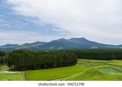 Mount Aso volcano and green field in Kumamoto, Japan.