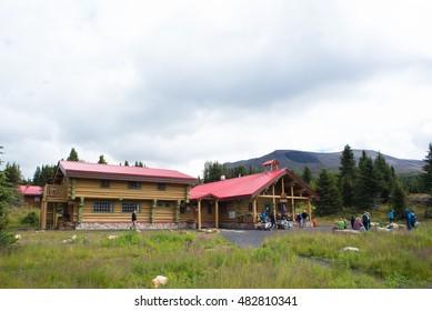 MOUNT ASSINIBOINE PROVINCIAL PARK, BRITISH COLUMBIA CAN - AUGUST 28, 2016: Assiniboine Lodge. Hikers rest outside on the Assiniboine Lodge British Columbia, Canada.