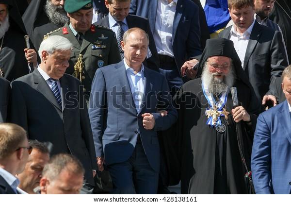 Mount Athos, Greece - May 28, 2016: Russian President Vladimir Putin, (C), President of Greece Prokopis Pavlopoulos, (L), the highest abbot of Mount Athos Pavlos (R) during his visit to Mount Athos.