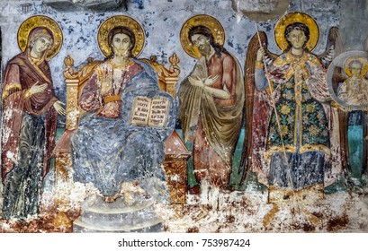 Mount Athos, Greece - October 26, 2017: Timeworn frescoes of saints on the outer side of the Church of Protaton in Karyes, Mount Athos