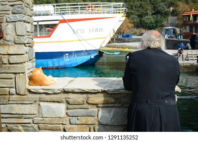 Mount Athos, Greece - October 31, 2018: Monk looking to the sea at Dafni port on Holy mountain Athos