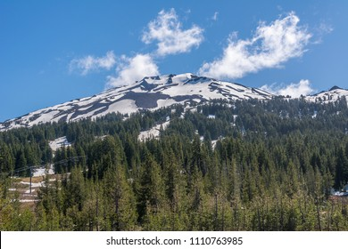Mount Bachelor near Bend, Oregon photographed in late spring from the northeast near the entrance to a ski area after the season closed. Mount Bachelor is one of the largest ski resorts in the US.