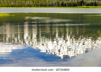 Mount Bachelor in Oregon being reflected in a lake