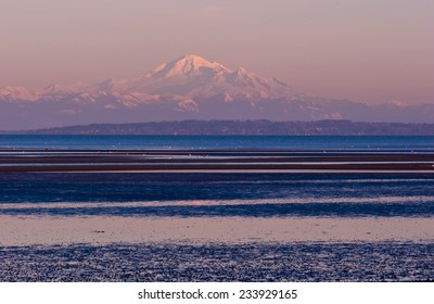 Mount Baker as seen across Boundary Bay from Tsawwassen, BC, Canada at sunset