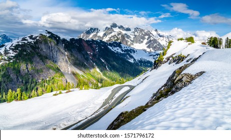 Mount Baker, Washington. USA. Winding mountain road trough snow with Mount Shuksan in the background.