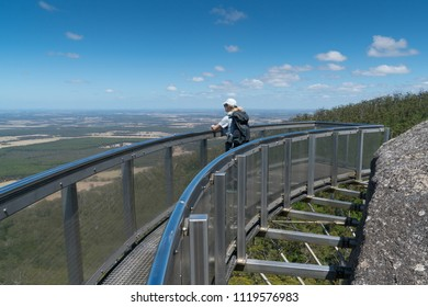 MOUNT BARKER, AUSTRALIA - FEBRUARY 2, 2018: Tourist standing on the amazing lookout on Castle Rock, highlight within the Porongurup National Park on February 2, 2018 in Western Australia