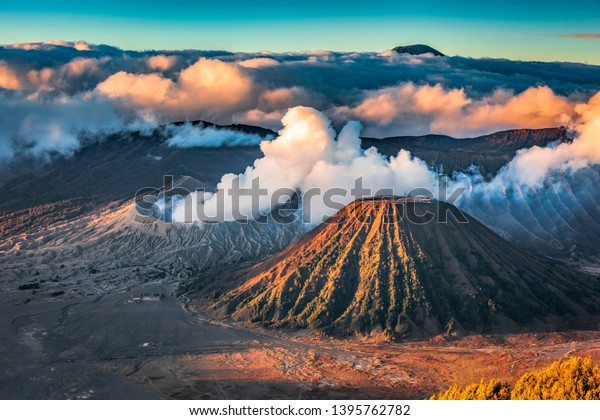 Mount Bromo eruption high resolution image with beautiful clouds background and Semeru volcano, its famous tourist destination in East Java, Indonesia.