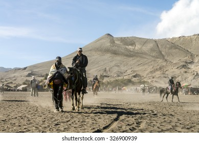 MOUNT BROMO VOLCANO, INDONESIA - SEP 20: Horseman lead tourist on horse at Mount Bromo in late morning on Sep 20, 2015 in East Java, Indonesia.