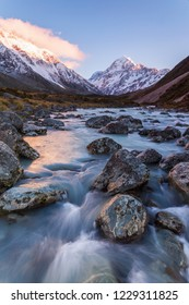 Mount Cook with Hooker River flowing as a foreground in the dawn at Aoraki Mount Cook National Park, Canterbury, New Zealand