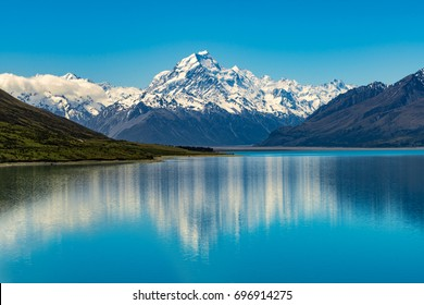 Mount Cook landscape reflection on Lake Pukaki, the highest mountain in New Zealand and popular travel destination.