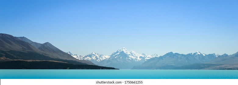 Mount Cook New Zealand Landscape Lake Pukaki. Aoraki Mt Cook the Highest Mountain New Zealand. Popular Travel Destination South Island NZ. Landscape Scenery Banner Background. Blue Turquoise Lake.