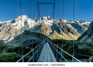 Mount Cook, New Zealand- March 31, 2018:Walking over the wooden bridge along the Hooker Valley Track, Mount Cook in New Zealand