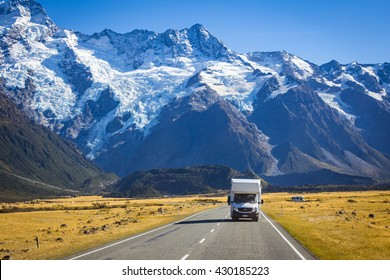 MOUNT COOK NEW ZEALAND-APRIL 15, 2016: tourist campervan on the road with Mt. Cook view on background in the South Island of New Zealand