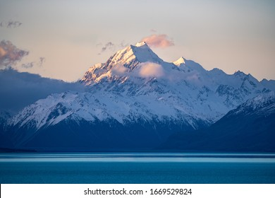 Mount Cook from Pukaki lake. Lake on the foreground with mountains on the background. Beautiful sunset with a colorful sky