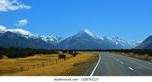 mount cook and spectacular glaciated mountain  scenery on a sunny day in summer  on the  road to  mount cook village on the south island of new zealand