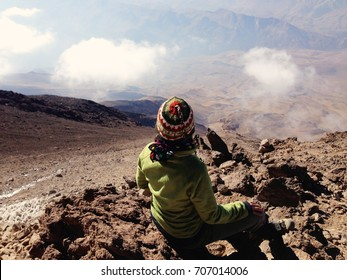 MOUNT DAMAVAND, IRAN - October 2016: Young woman climbing Damavand Volcano in Iran, the highest mountain in Iran. Breathtaking view of the mountain landscape, Iran