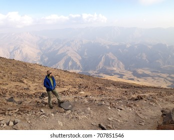 Mount Damavand, Iran - October 2016: Young woman at Damavand Mountain in Iran. Highest volcano in Iran Damavand, Iran