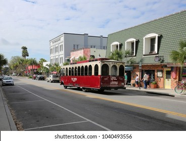 MOUNT DORA, FL, USA - FEBRUARY 25:  A trolley stops to pick up passengers on Donnelly Street, a popular tourist shopping destination in the heart of downtown Mount Dora, as seen on February, 25, 2018
