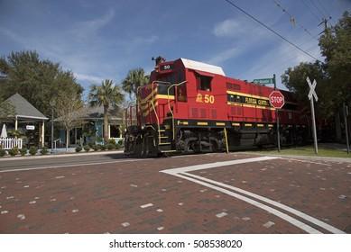Mount Dora Florida USA - October 2016 - A freight pulling locomotive passing through the center of Mount Dora a small Florida town.