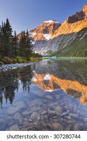 Mount Edith Cavell reflected in Cavell Lake in Jasper National Park, Canada. Photographed at sunrise.