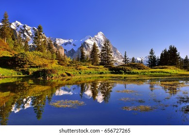 Mount Eiger reflect in a mountain lake near Grindelwald in Switzerland