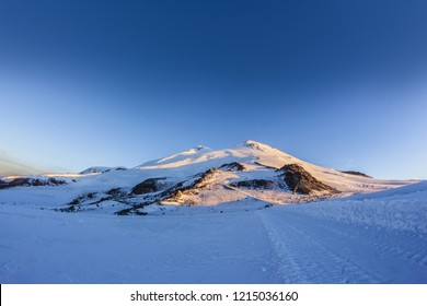 Mount Elbrus against the blue sky at dawn